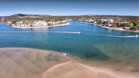 Stock aerial photograph picture image of hire boat on Noosa River Queensland Australia,  Featuring noosa river, the spit, queensland tourism and the sound