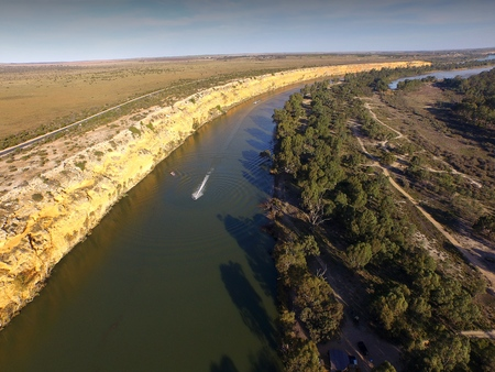 water  skier: Jet Ski aerial view of river murray cliffs at big bend near nildottie in murray darling basin on edge of mallee and drought affected areas in australia. Popular tourism water ski and wake boarding area.