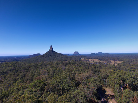 qld: Aerial images view pictures photos of australian glasshouse mountain range on sunshine coast, queensland tourism holiday area. Featuring mount tibrogargan, mount coonowrin, mt beerwah and mt Tibberoowuccum