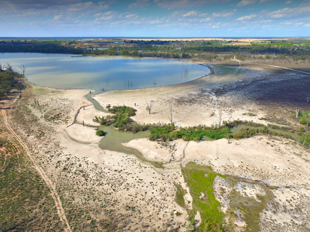 salt marsh: Elevated Aerial view from helicopter of murray river wetlands lagoons and back water along the river murray darling basin in South Australia. On edge of drought stricken irrigation area and affected mallee areas in outback australia and riverland showing  Stock Photo