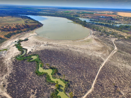 affected: Elevated Aerial view from helicopter of murray river wetlands lagoons and back water along the river murray darling basin in South Australia. On edge of drought stricken irrigation area and affected mallee areas in outback australia and riverland showing  Stock Photo