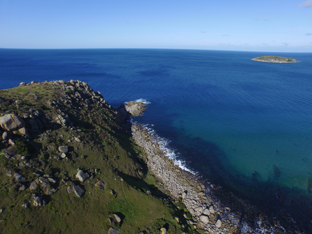 encounter: Helicopter aerial view of the Bluff at Encounter Bay Victor Harbor Harbour South Australia on Fleurieu Peninsula, Tourism Holiday Area, featuring large cliffs that reach into the Southern Ocean.