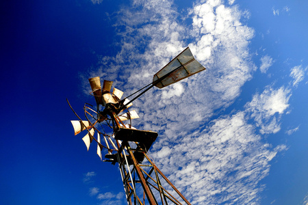 salinity: Vintage Windmill Background on rural farming property pumping live stock bore from underground water table in salty, saline drought stricken outback environment with history