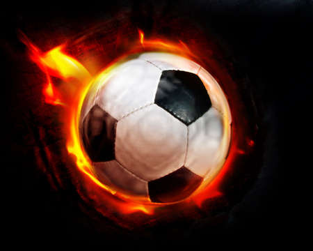 socca: Football through flames Stock Photo