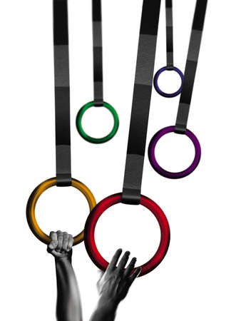 creative strength: Gymnast grasping rings