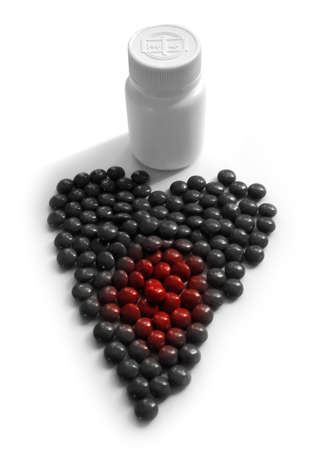 Medicine Pills in shape of Heart photo