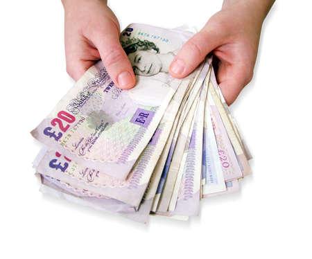 giving money: Holding money Stock Photo