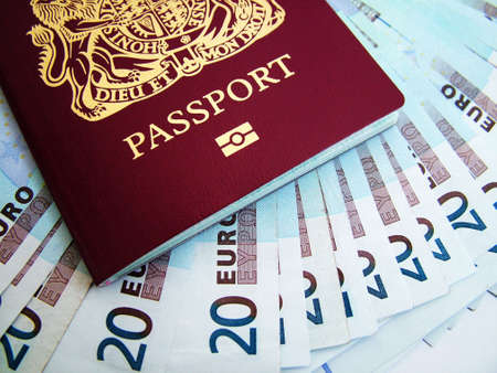 holiday spending: Passport with money