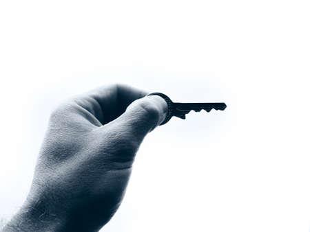 Hand holding key photo