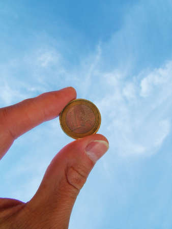 Hand holding Euro coin photo