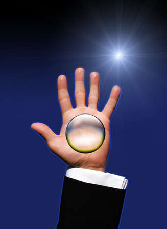 Crystal ball in hand photo