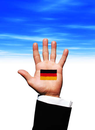 German flag on palm of hand photo