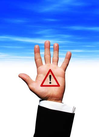 Alarm symbol in hand photo