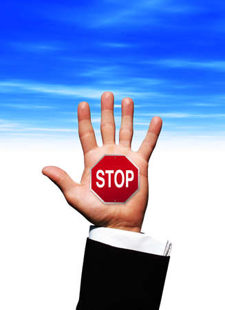 Stop sign in hand photo