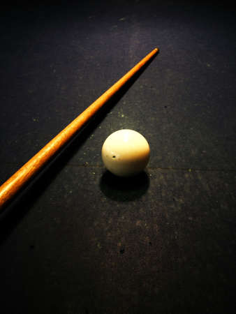 billiards tables: Pool cue and white ball Stock Photo