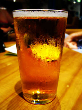 beerhouse: Pint glass of lager Stock Photo