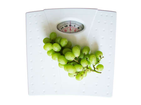 overeat: Grapes on weighing scales