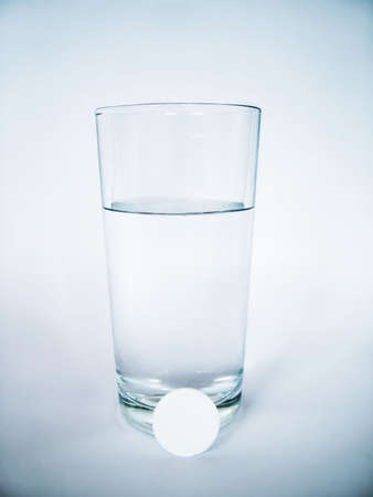 Tablet and glass of water Stock Photo - 4753883
