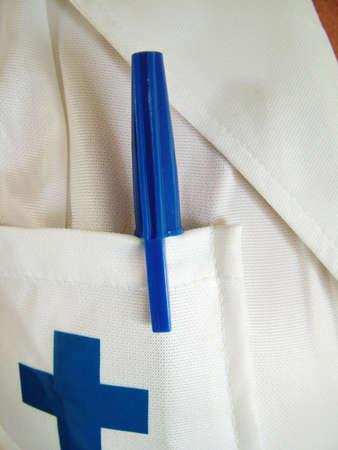 Nurse uniform and pen photo