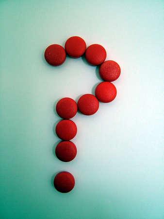 medical decisions: Question mark pills
