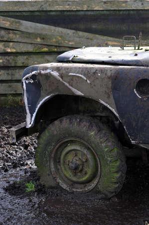 Flat tire in mud photo