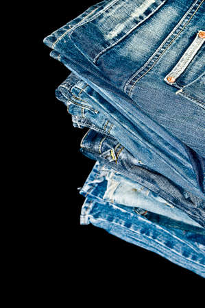 blue denim: Folded blue Denim jeans