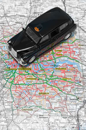 black cab: London taxi cab on map of london