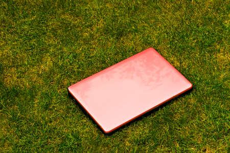 powerbook: Pink laptop outside