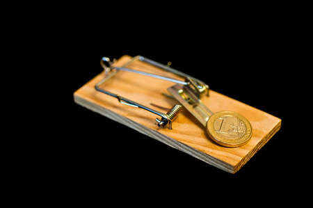 mouse trap: Euro coin on mouse trap