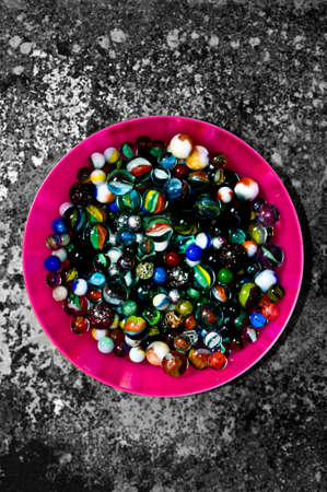 marbles close up: Glass marbles in container