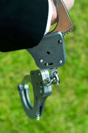 criminal: criminal handcuffs Stock Photo