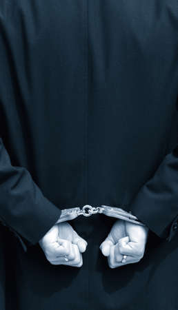 cuffed: Hands in handcuffs behind back
