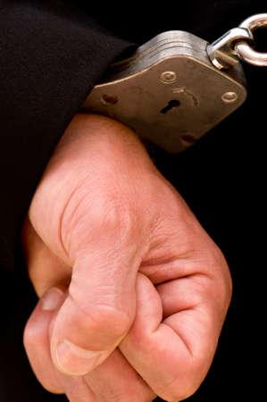criminal defense: Hand in handcuffs Stock Photo