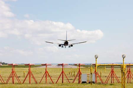 aircraft landing: Passenger aircraft landing on runway