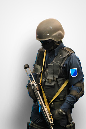 counter terrorism: man black ops outfit in black ready for orders