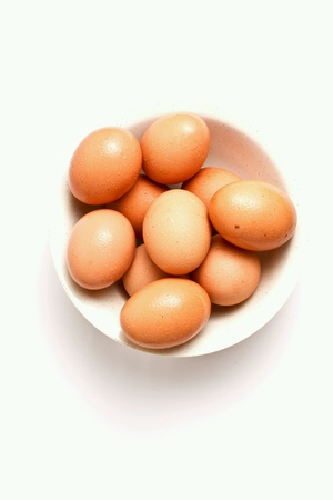 protien: Eggs in a bowl isolated Stock Photo