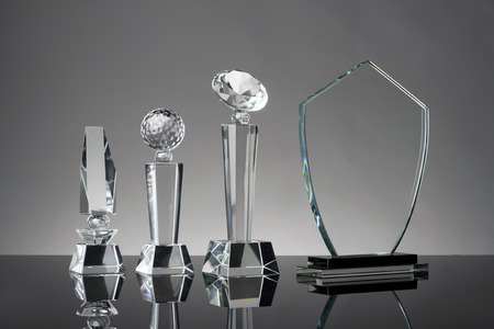 glass trophy in gray background Standard-Bild