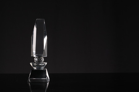 award background: glass trophy in black background Stock Photo