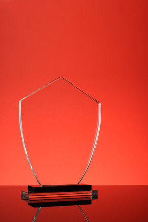 award trophy: glass trophy in red background