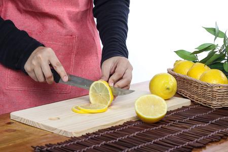 clean environment: woman cutting lemon in clean environment Stock Photo