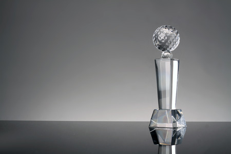 background trophy: glass trophy in gray background Stock Photo