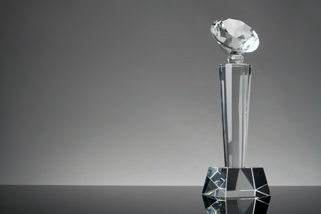 competition success: glass trophy in gray background Stock Photo
