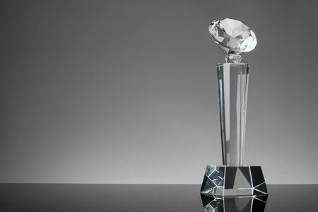 glass trophy in gray background Foto de archivo