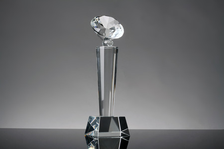 award trophy: glass trophy in gray background Stock Photo