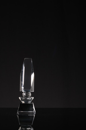 glass cup: glass trophy in black background Stock Photo