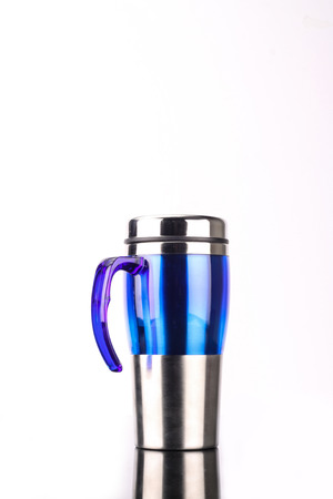 insulated drink container: steel mug isolated on white background