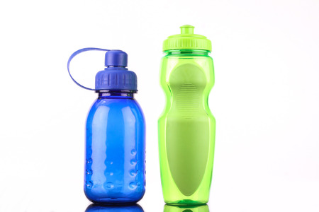blue and green bottles isolated on white background