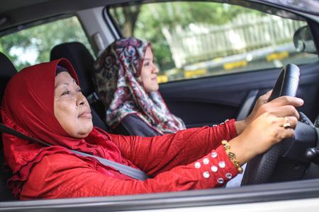 two muslim women in the car