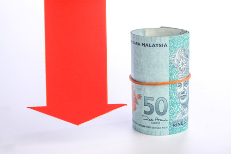 red arrow: red arrow with rolls of malaysian money isolated on white background Stock Photo