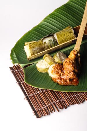 malay lemang served with rendang ayam